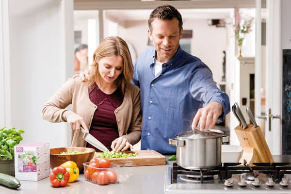 Two people making dinner